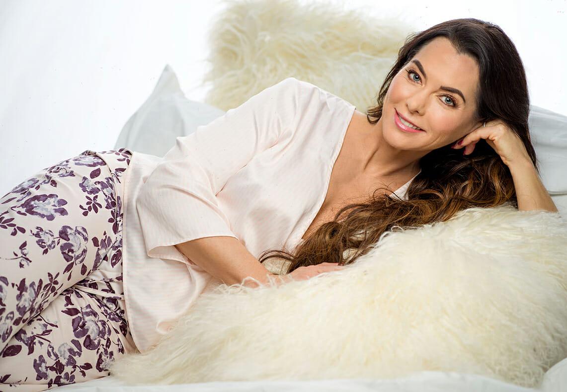 Portrait laying down silk pajamas